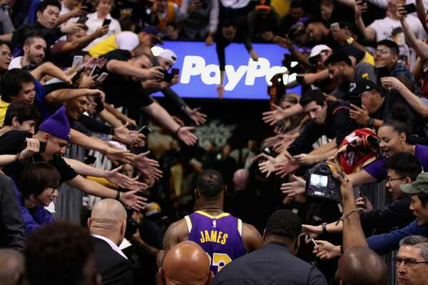 PHOENIX, ARIZONA - NOVEMBER 12: LeBron James #23 of the Los Angeles Lakers walks off the court past fans following the NBA game against the Phoenix Suns at Talking Stick Resort Arena on November 12, 2019 in Phoenix, Arizona. The Lakers defeated the Suns 123-115. NOTE TO USER: User expressly acknowledges and agrees that, by downloading and/or using this photograph, user is consenting to the terms and conditions of the Getty Images License Agreement (Photo by Christian Petersen/Getty Images)