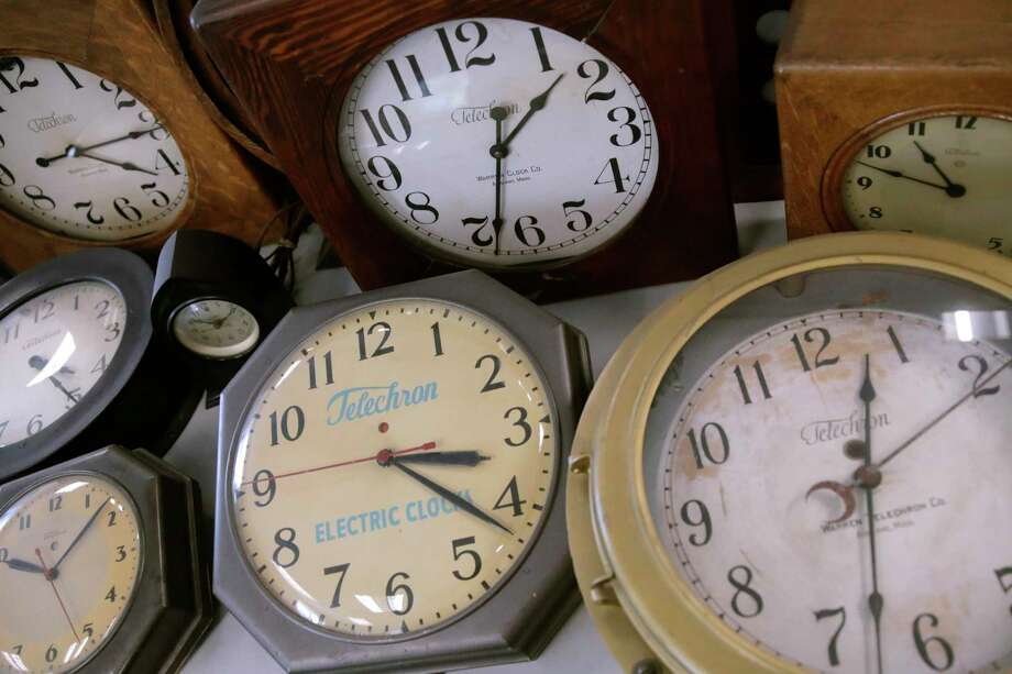 In this Thursday, March 5, 2020, photo, antique clocks are displayed at the Electric Time Company, in Medfield, Massachusetts. Most Americans will lose an hour of sleep this weekend, but gain an hour of evening light for months ahead, as Daylight Saving Time returns this weekend. The time change officially starts Sunday at 2 a.m. local time. (AP Photo/Charles Krupa) Photo: Charles Krupa / Associated Press / Copyright 2020 The Associated Press. All rights reserved.