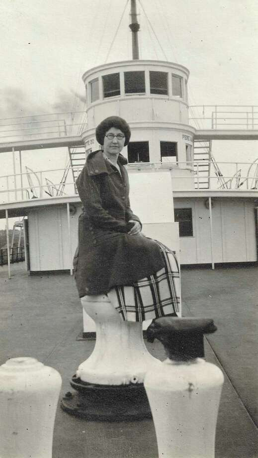 """Unknown woman on deck of car ferry. Written on the picture is """"you do not seem to feel at home on a boat, but you are some sailor on land"""". (Courtesy Photo)"""