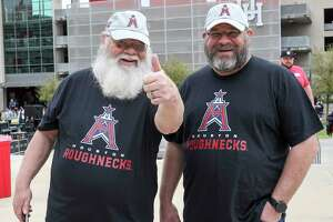 Fans pose for a photo before an XFL game between the Houston Roughnecks and the Seattle Dragons on Saturday, March 7, 2020, at TDECU Stadium in Houston.