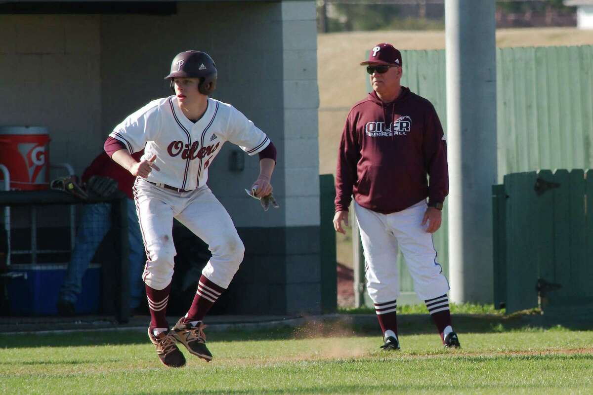 Pearland baseball coach David Rogers (right) hopes Carter Allen (leading off third base) and the rest of the Oilers can feed off their 6-0 start to the season.