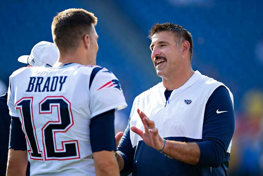 Head Coach Mike Vrabel of the Tennessee Titans talks with Tom Brady #12 of the New England Patriots before a week two preseason game at Nissan Stadium on August 17, 2019 in Nashville, Tennessee. (Wesley Hitt/Getty Images/TNS) Photo: Wesley Hitt, TNS