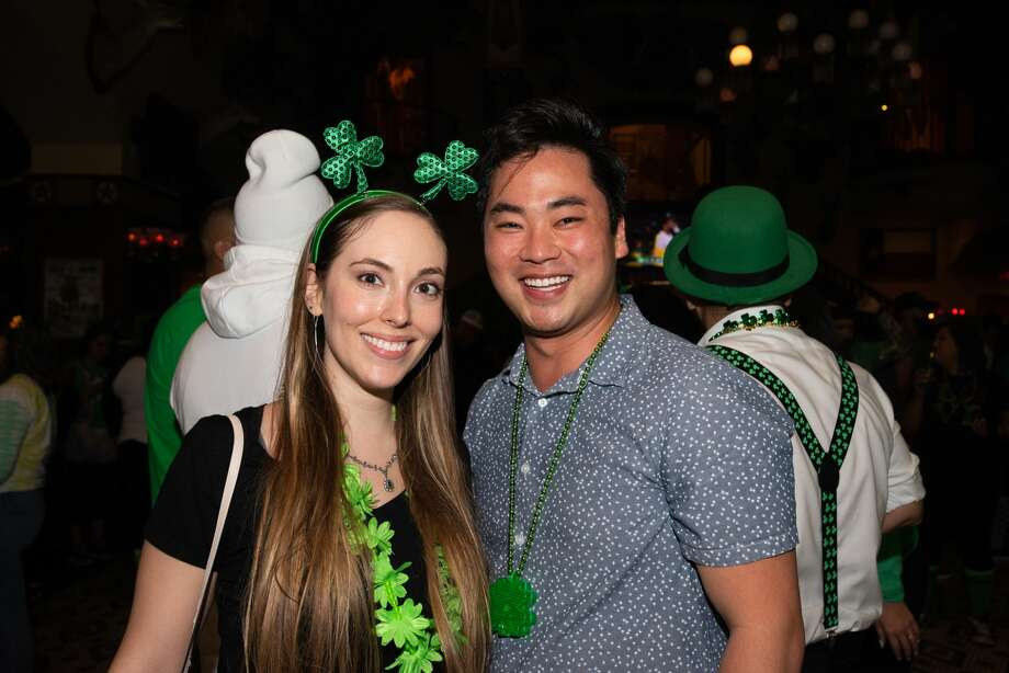 San Antonians made their way downtown to attend the First Friday Pub Run with the St. Patrick's theme on Friday, March 6, 2020. Photo: Aiessa Ammeter