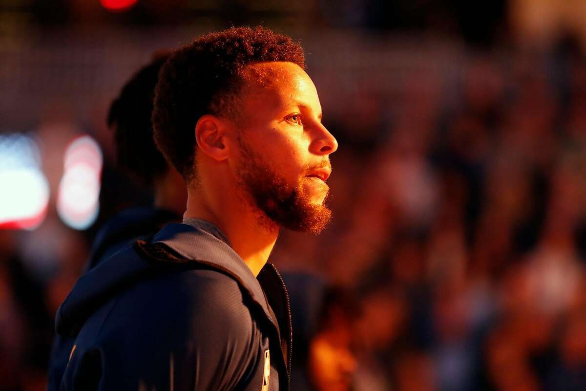 Golden State Warriors' Stephen Curry during National Anthem before 121-113 loss to Toronto Raptors during NBA game at Chase Center in San Francisco, Calif., on Thursday, March 5, 2020.