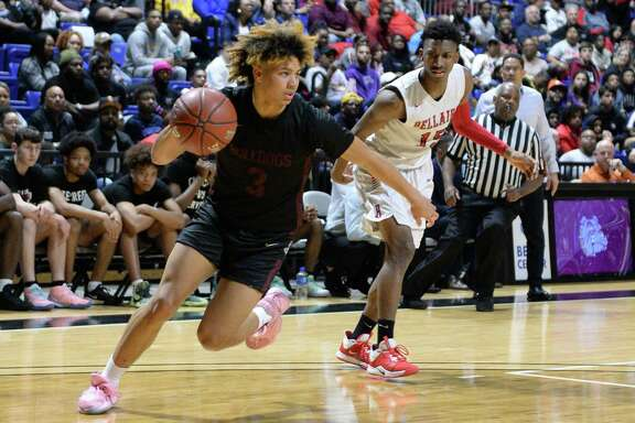 JaVon Jackson (3) of Summer Creek drives around Tyrell Palmer (15) of Bellaire during the first quarter of the Boys 6A Region III semifinal basketball game between the Bellaire Cardinals and the Summer Creek Bulldogs on Friday, March 6, 2020 at the Berry Center, Cypress, TX.
