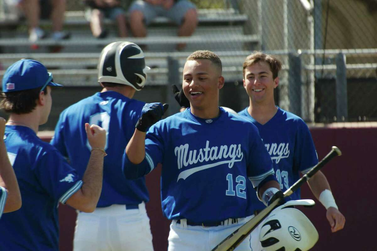 Friendswood's Max Mims (12) is congratulated after his home run Friday against Clear Creek at Clear Creek High School. Mims went 3-for-4 with two home runs and four runs batted in.