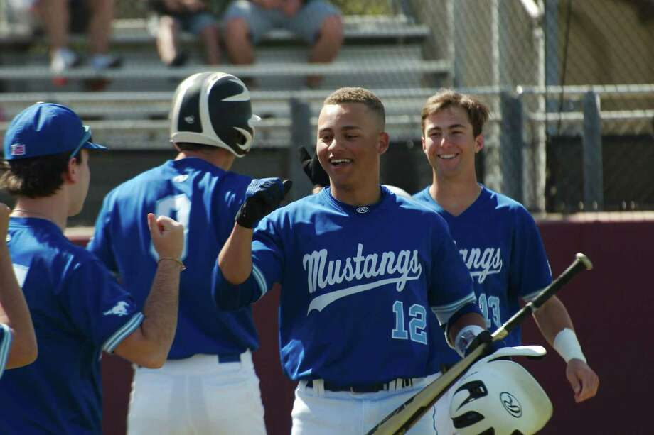 Friendswood's Max Mims (12) is congratulated after his home run Friday against Clear Creek at Clear Creek High School. Mims went 3-for-4 with two home runs and four runs batted in. Photo: Kirk Sides / Staff Photographer / © 2020 Kirk Sides / Houston Chronicle