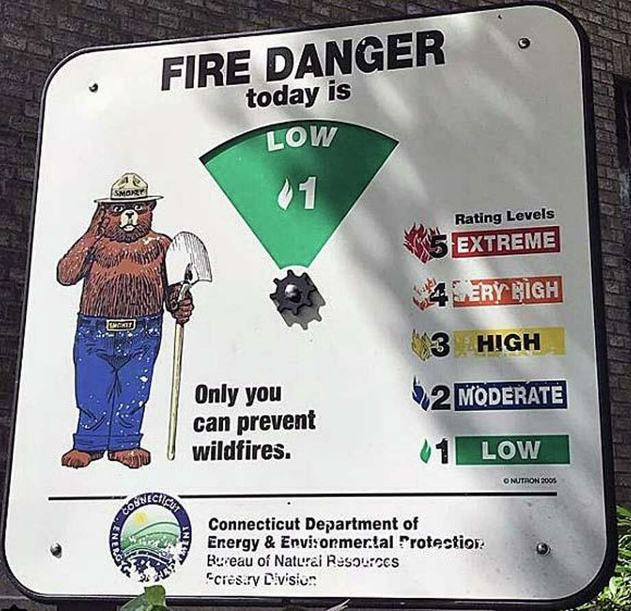 File photo of a forest fire danger rating sign, which indicated that the rating for that day was low. However, on Saturday, March 7, 2020, the forest fire danger rating is high, according to DEEP. Photo: Contributed Photo / DEEP / Contributed Photo / Connecticut Post Contributed