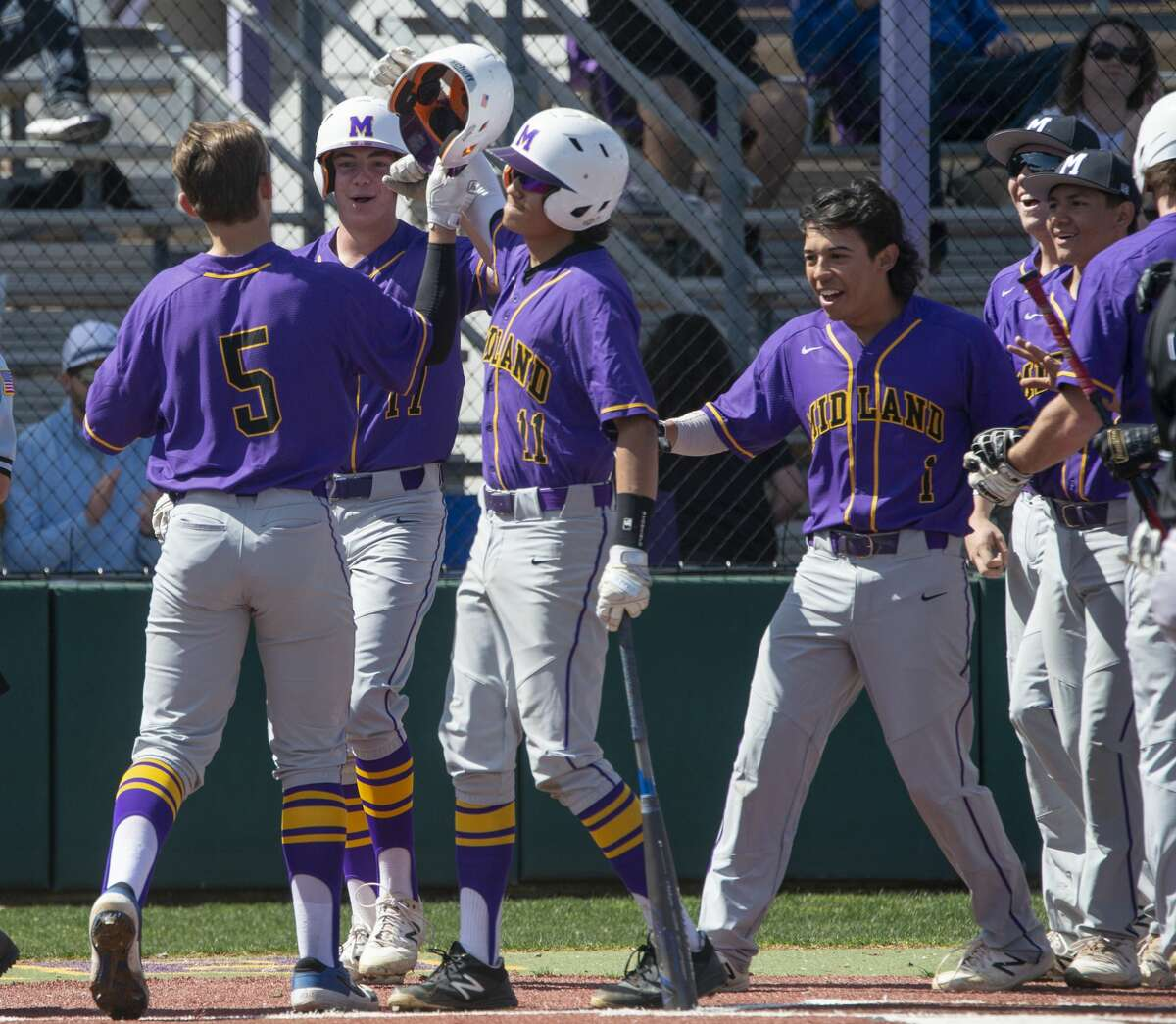 Midland High's Landry Walls, , in congratulated on a three run homerun 03/07/2020 against El Paso Franklin in the Tournament of Champions at Zachery Field. Tim Fischer/Reporter-Telegram