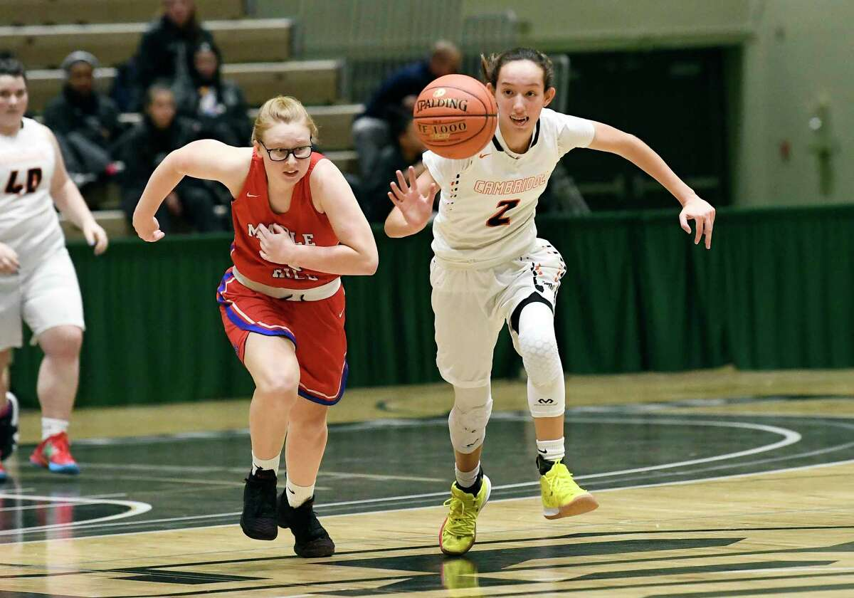 Cambridge's Sophie Phillips (2) steals the ball from Maple Hill's Paige Bleau (4) during a girls' Section II Class C high school championship basketball game Saturday, March 7, 2020 in Troy, N.Y. (Hans Pennink / Special to the Times Union) ORG XMIT: 030820_hsbb_girls3_HP106