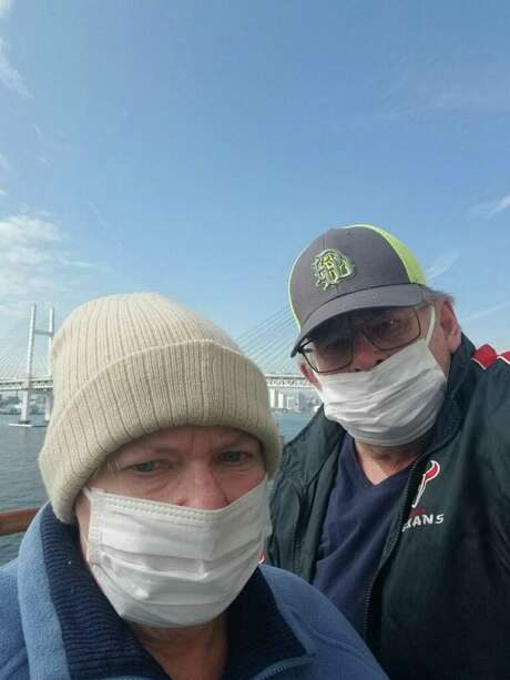 Terri and Dave Feil of Houston, shown aboard the Diamond Princess cruise ship while it was docked at a port in Japan. They would be ordered to stay for two weeks in isolation at Joint Base San Antonio-Lackland. Photo: /Courtesy Of The Feils