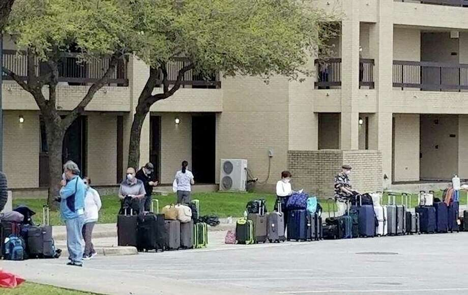 The evacuees stayed in a hotel at Joint Base San Antonio-Lackland. Most were cleared to leave the quarantine on Monday, March 2, 2020. They had packed and carried their suitcases outside before being told they would not be discharged that day. Photo: /Courtesy Of Terri Feil