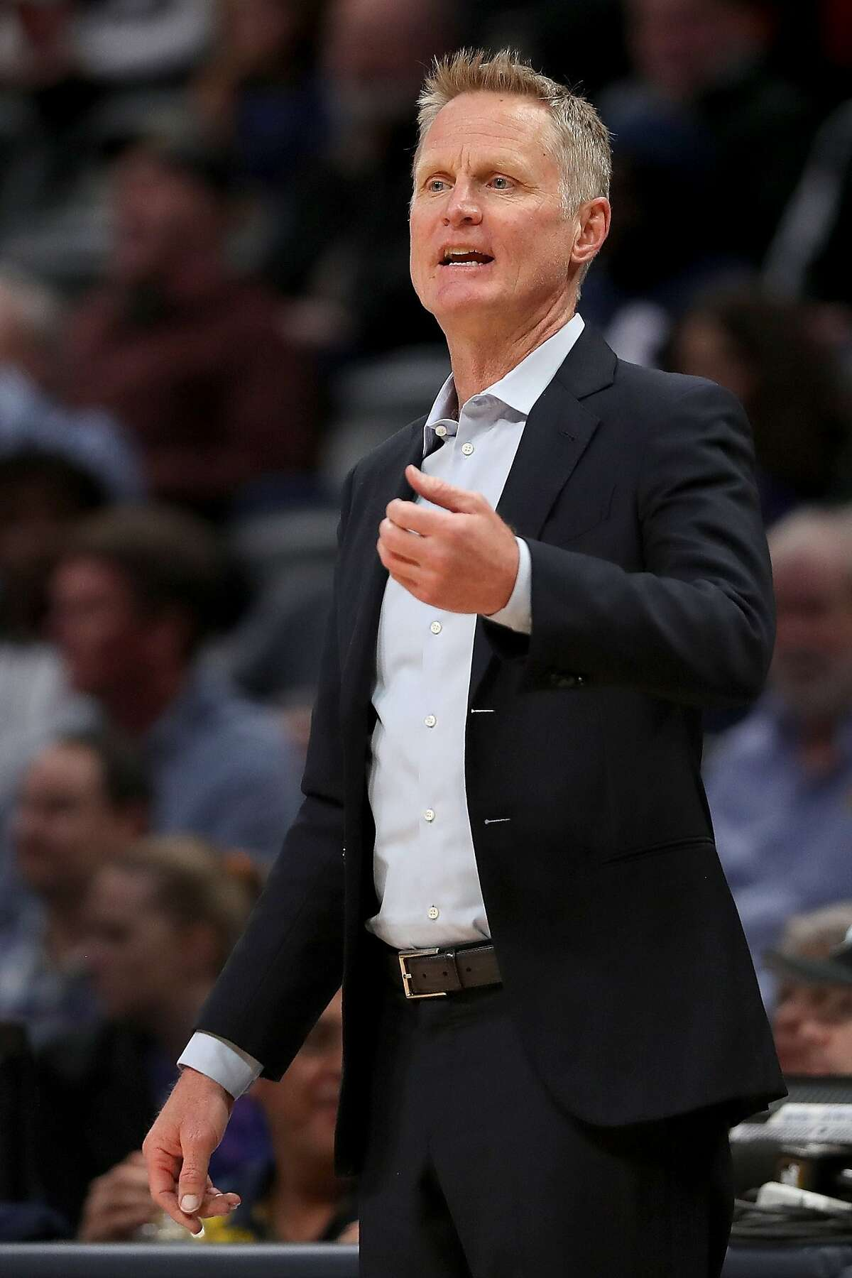 Head coach Steve Kerr of the Golden State Warriors works the sidelines against the Denver Nuggets in the first quarter at the Pepsi Center on March 03, 2020 in Denver, Colorado.