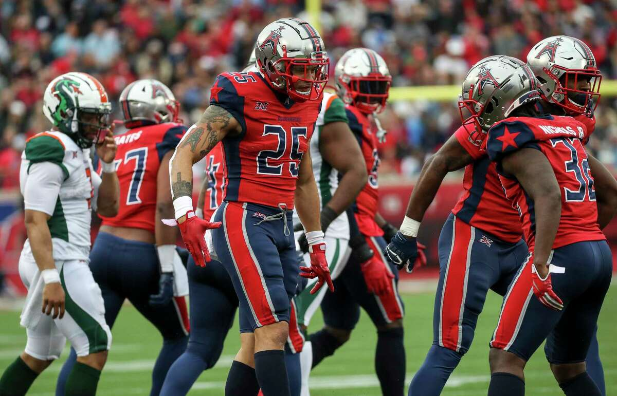 Houston Roughnecks safety Cody Brown (25) celebrates with cornerback Deatrick Nichols (32) during the third quarter of an XFL game on Saturday, March 7, 2020, at TDECU Stadium in Houston.