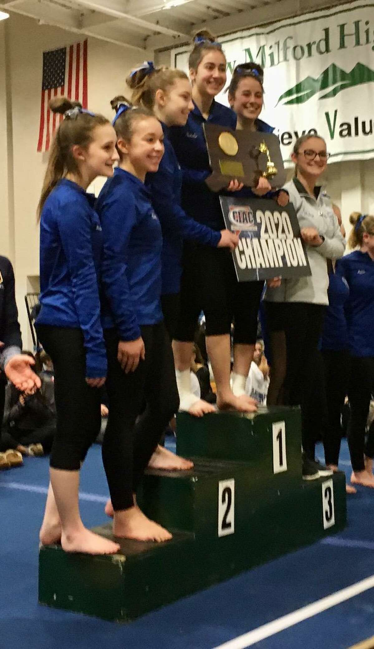 The Southington girls gymnastics team celebrates its 2020 State Open team title Saturday at New Milford