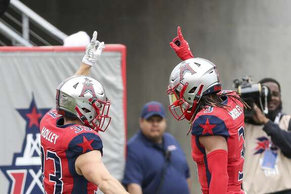Houston Roughnecks running back Nick Holley (33) celebrates with wide receiver Sam Mobley (3) after Holley scored a touchdown during the second quarter of an XFL game on Saturday, March 7, 2020, at TDECU Stadium in Houston.