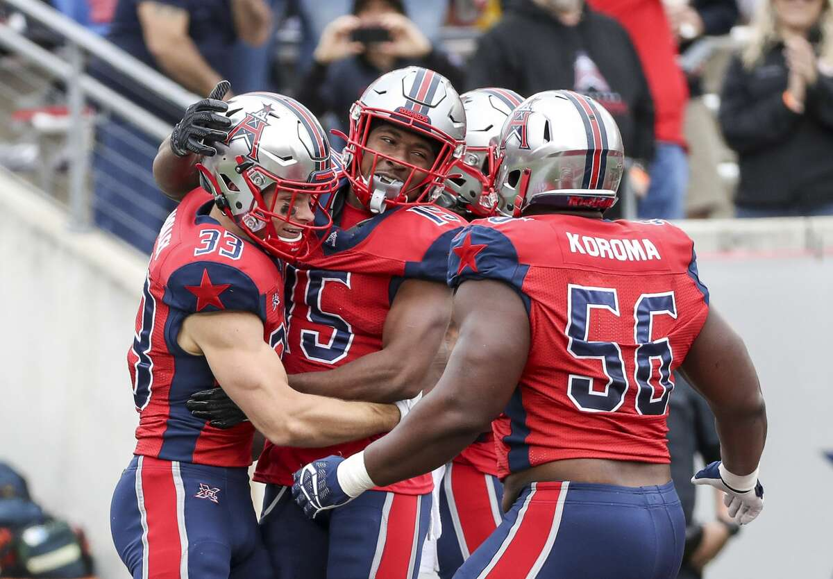 Houston Roughnecks running back Nick Holley (33) celebrates with teammates after scoring a touchdown during the second quarter of an XFL game on Saturday, March 7, 2020, at TDECU Stadium in Houston.