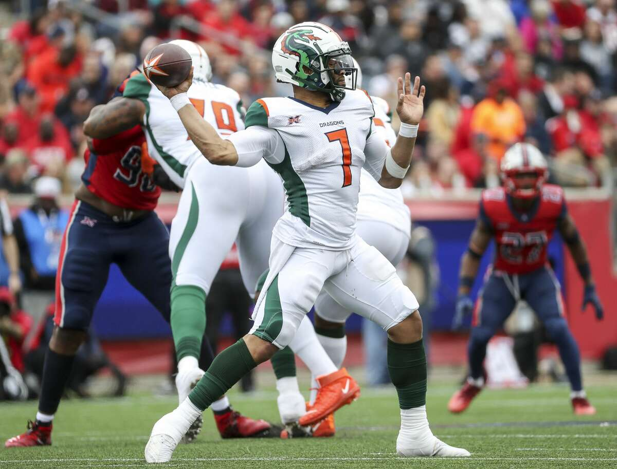 Seattle Dragons quarterback B.J. Daniels (7) drops back to pass during the second quarter of an XFL game on Saturday, March 7, 2020, at TDECU Stadium in Houston.