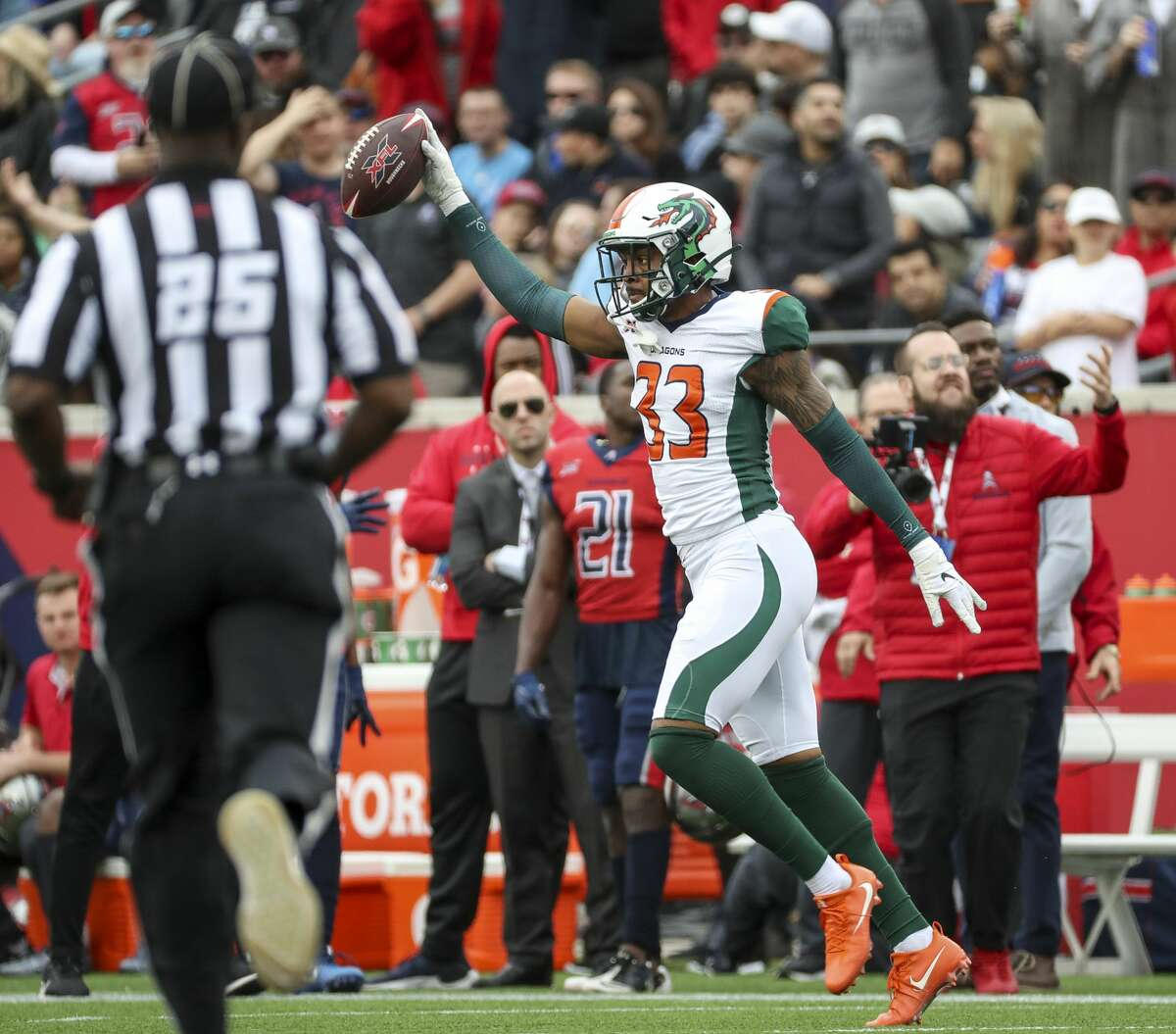 Seattle Dragons safety Jordan Martin (33) celebrates after intercepting a pass intended for Houston Roughnecks wide receiver Sam Mobley (3) during the third quarter of an XFL game on Saturday, March 7, 2020, at TDECU Stadium in Houston.