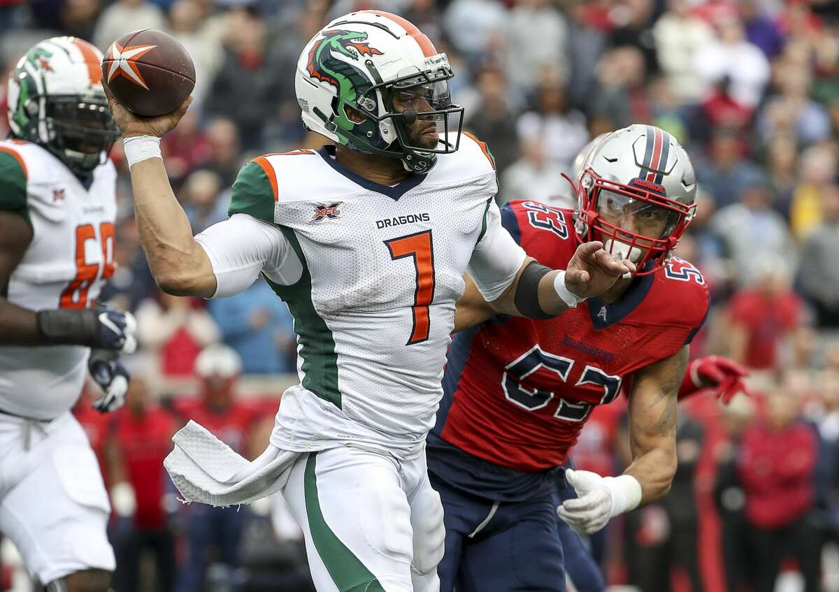 Seattle Dragons quarterback B.J. Daniels (7) passes under pressure from Houston Roughnecks linebacker Drew Lewis (53) on third down during the fourth quarter of an XFL game on Saturday, March 7, 2020, at TDECU Stadium in Houston.
