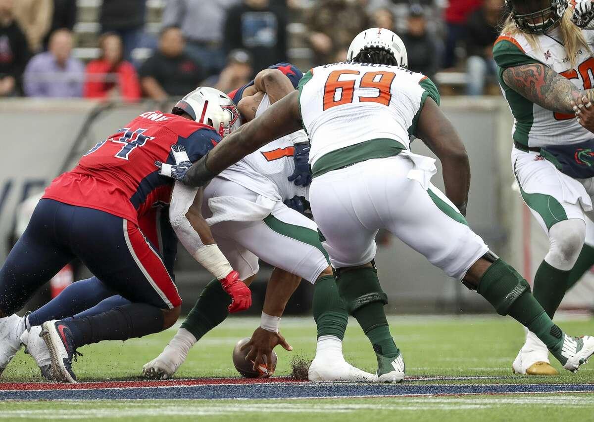 Seattle Dragons quarterback B.J. Daniels (7) fumbles during the fourth quarter of an XFL game on Saturday, March 7, 2020, at TDECU Stadium in Houston.