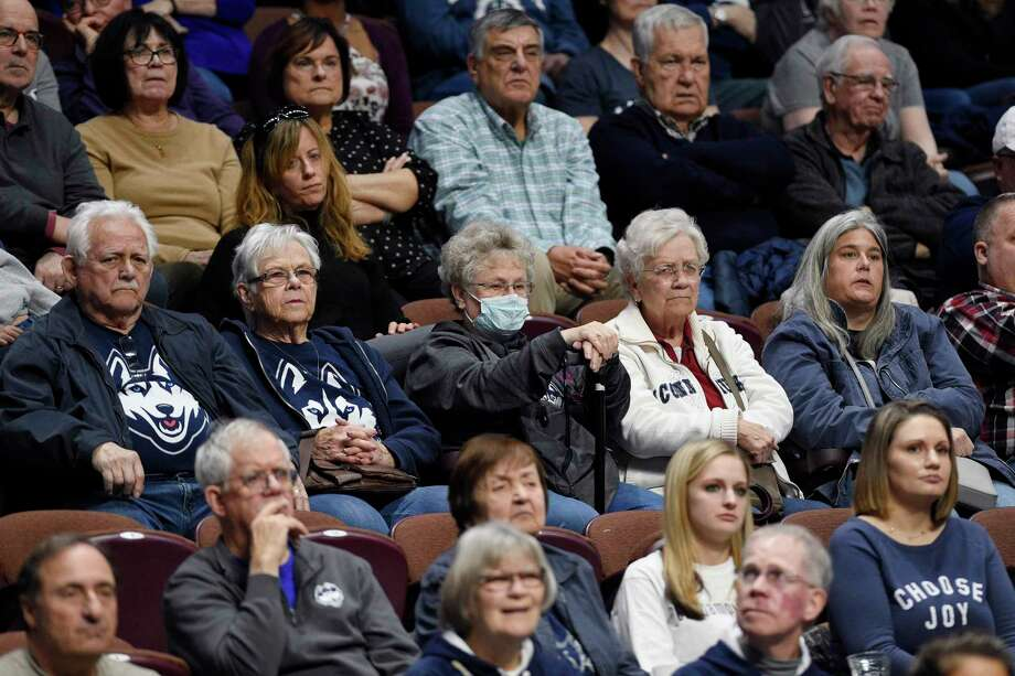 Fans watch Saturday's game between UConn and Temple in the American Athletic Conference tournament quarterfinals at the Mohegan Sun Arena in Uncasville. Photo: Jessica Hill / Associated Press / Copyright 2020 The Associated Press. All rights reserved.