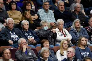 Fans watch Saturday's game between UConn and Temple in the American Athletic Conference tournament quarterfinals at the Mohegan Sun Arena in Uncasville.