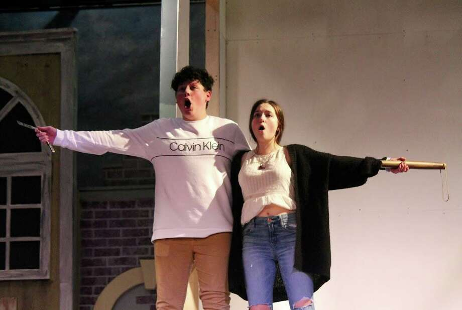 """David Rosenthal, left, as Sweeney Todd and Sophia Coppola, right, as Mrs. Lovett, rehearsing a scene from the upcoming Branford High School Performing Arts production of Stephen Sondheim's """"Sweeney Todd: The Demon Barber of Fleet Street."""" The play will feature many of the authentic props from Seaview Productions' successful Off-Broadway production of """"Sweeney Todd"""" at The Barrow Street Theatre in New York City. (Including the ones in their hands.) The play will run March 18-22 in the Cathyann Roding Auditorium at Branford High. Tickets are $18 for adults and $15 for students at seniors, available online at http://thechoirlobby.com. Photo: Contributed / Ariel Cobden / Branford High School Performing Arts /"""