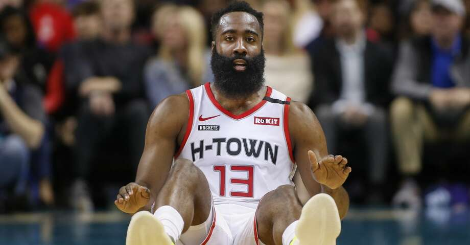 Houston Rockets guard James Harden sits on the court after being fouled during the first half of an NBA basketball game against the Charlotte Hornets in Charlotte, N.C., Saturday, March 7, 2020. (AP Photo/Nell Redmond) Photo: Nell Redmond/Associated Press