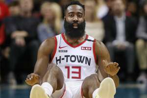 Houston Rockets guard James Harden sits on the court after being fouled during the first half of an NBA basketball game against the Charlotte Hornets in Charlotte, N.C., Saturday, March 7, 2020. (AP Photo/Nell Redmond)