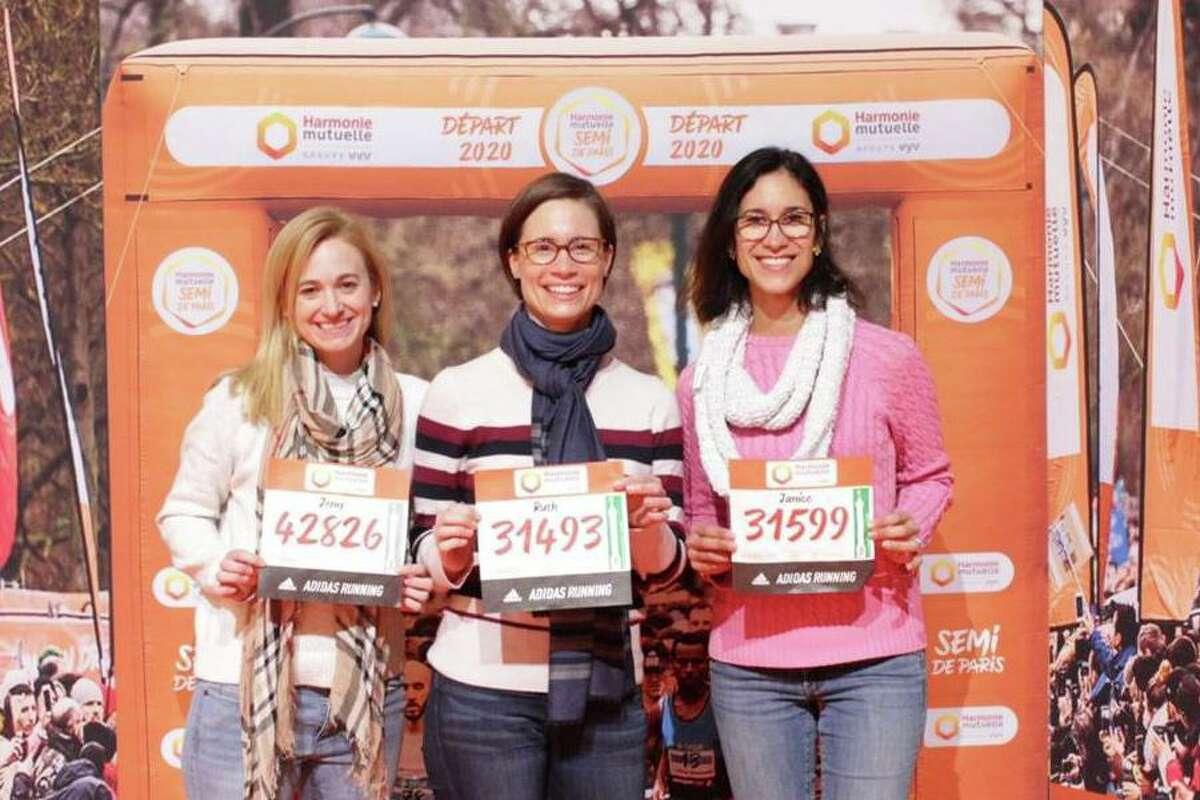 Jennifer Warren, Ruth Clark, and Janice Cruz Cardona at the half marathon race expo in Paris.