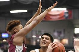 Lansingburgh's Quashawn McFarlane attempts to stop a shot by Meekel Christian's Ozzy Dejesus during the Class A Sectional Final at Cool Insuring Arena in Glens Falls, N.Y., on Saturday, Mar. 7, 2020. (Jenn March, Special to the Times Union)