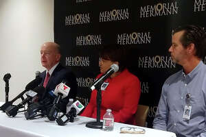 Dr. David Callender, president and CEO of Memorial Hermann Health System, Dr. Angela Shippy, chief medical and quality officer and Dr. John Butler, infectious diseases expert speak to the media about the 11 workers asked to self-quarantine for the next two weeks.