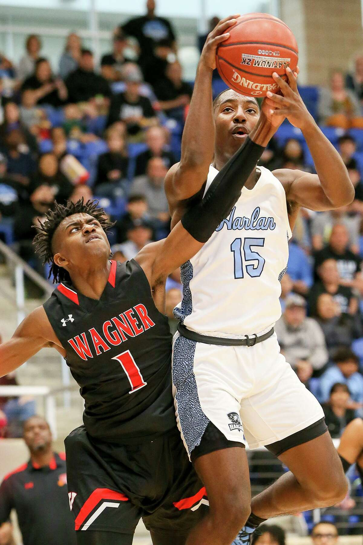 Wagner's JaSean Jackson, left, fights for a rebound with Harlan's Ja'kobe Barkley in the first half of their Class 5A Regional final game at Northside Gym on Saturday, March 7, 2020. Wagner advanced to the state tournament with a 64-48 victory over Harlan.