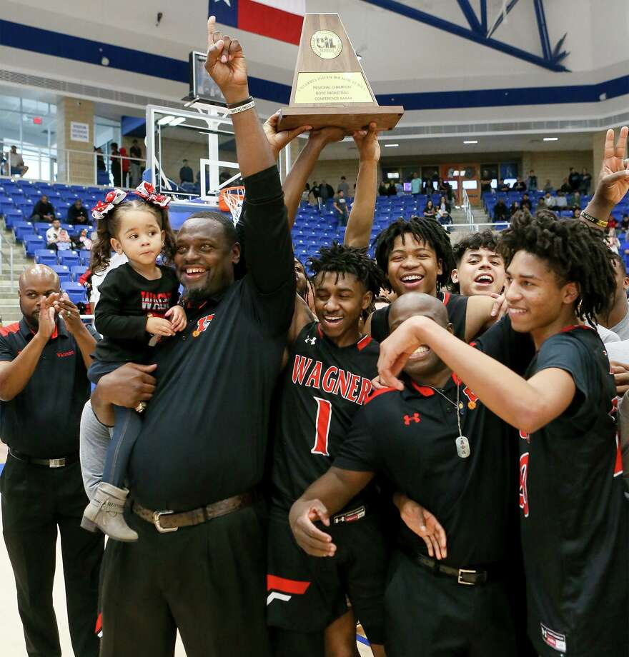 Wagner coach Rodney Clark and the Wagner Thunderbirds celebrate with their 5A regional championship win over Harlan at Northside Gym on March 7, 2020. Photo: Marvin Pfeiffer /Staff Photographer / **MANDATORY CREDIT FOR PHOTOG AND SAN ANTONIO EXPRESS-NEWS/NO SALES/MAGS OUT/TV