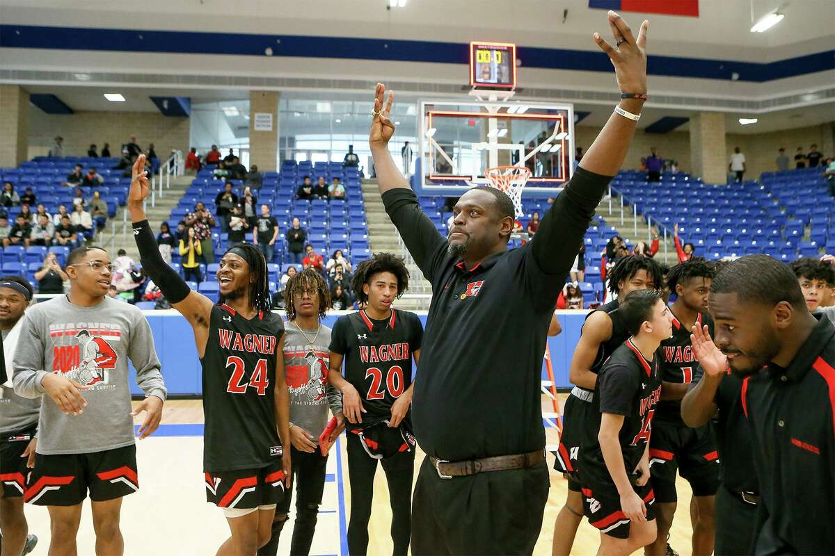 Coach Rodney Clark and the Wagner Thunderbirds celebrate their Class 5A Regional championship over Harlan at Northside Gym on Saturday, March 7, 2020. Wagner advanced to the state tournament with a 64-48 victory over Harlan.