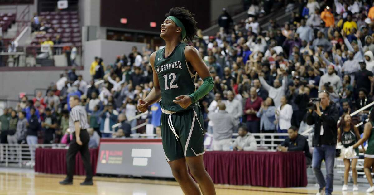Hightower guard Bryce Griggs leaps in celebration as the clock runs out against Shadow Creek to win the Class 5A Region III finals basketball game, held at the M.O. Campbell Education Center Saturday, Mar. 7, 2020 in Houston, TX.