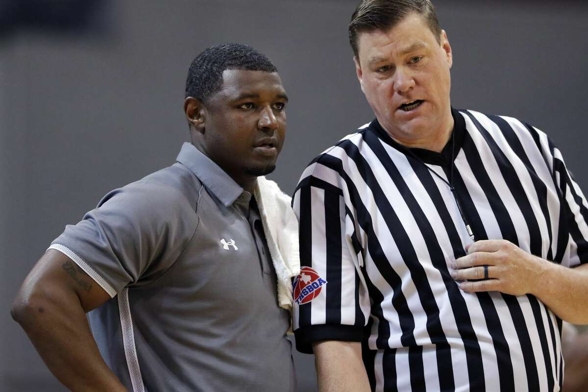 Hightower head coach Steven Woods talks with an official about a foul call during the Class 5A Region III finals basketball game against Shadow Creek, held at the M.O. Campbell Education Center Saturday, Mar. 7, 2020 in Houston, TX.