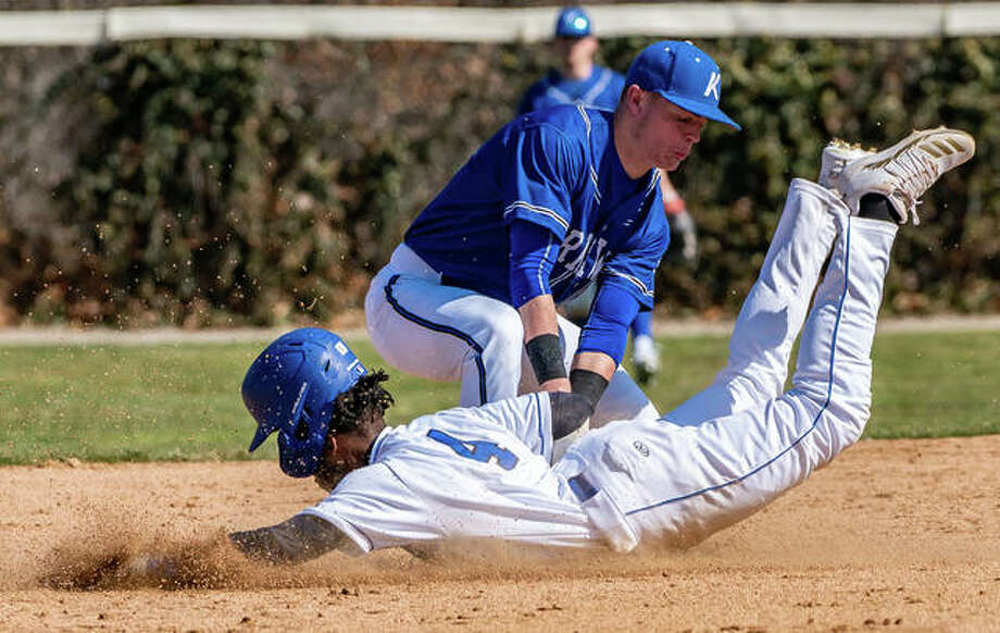 Lewis and Clark's Miles Hudson is tagged out by Kirkwood's Gave Lux (5) attempting to steal second base in the first game of a Saturday's doubleheader. Photo: Nathan Woodside | The Telegraph