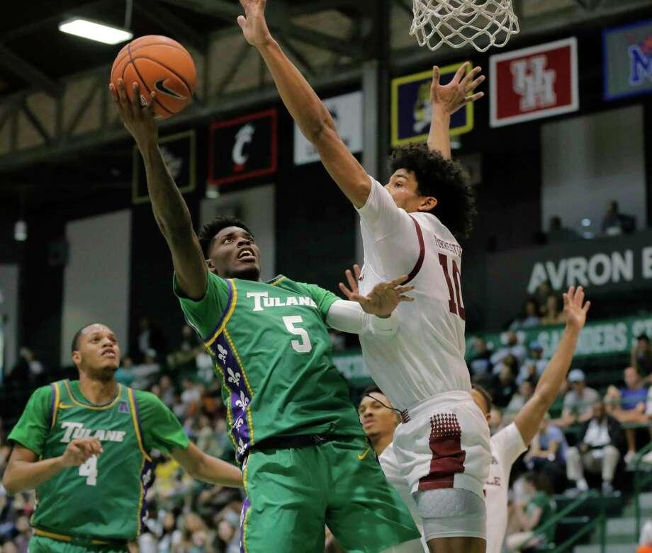 Teshaun Hightower (5) and the Tulane men's basketball team will host UConn on Sunday. Photo: David Grunfeld / Associated Press / © 2019 David Grunfeld/ The Times-Picayune | The Advocate