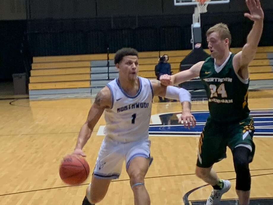 Northwood's Evan Lowden takes the ball to the basket during Saturday's GLIAC Tournament semifinal against Northern Michigan. Photo: Fred Kelly/fred.kelly@mdn.net