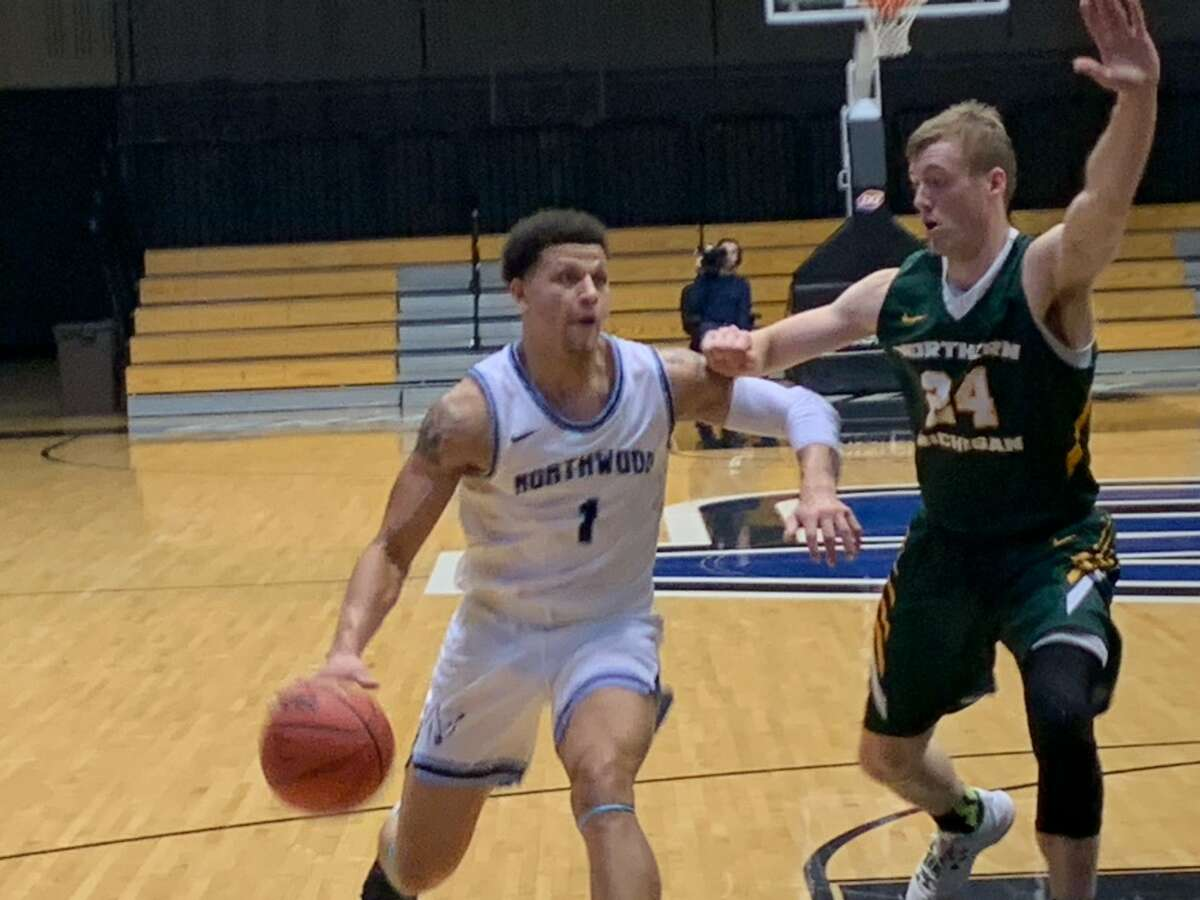 Northwood's Evan Lowden takes the ball to the basket during Saturday's GLIAC Tournament semifinal against Northern Michigan.