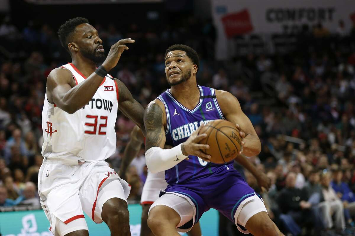 Charlotte Hornets forward Miles Bridges, right, drives to the basket against Houston Rockets forward Jeff Green during the first half of an NBA basketball game in Charlotte, N.C., Saturday, March 7, 2020. (AP Photo/Nell Redmond)