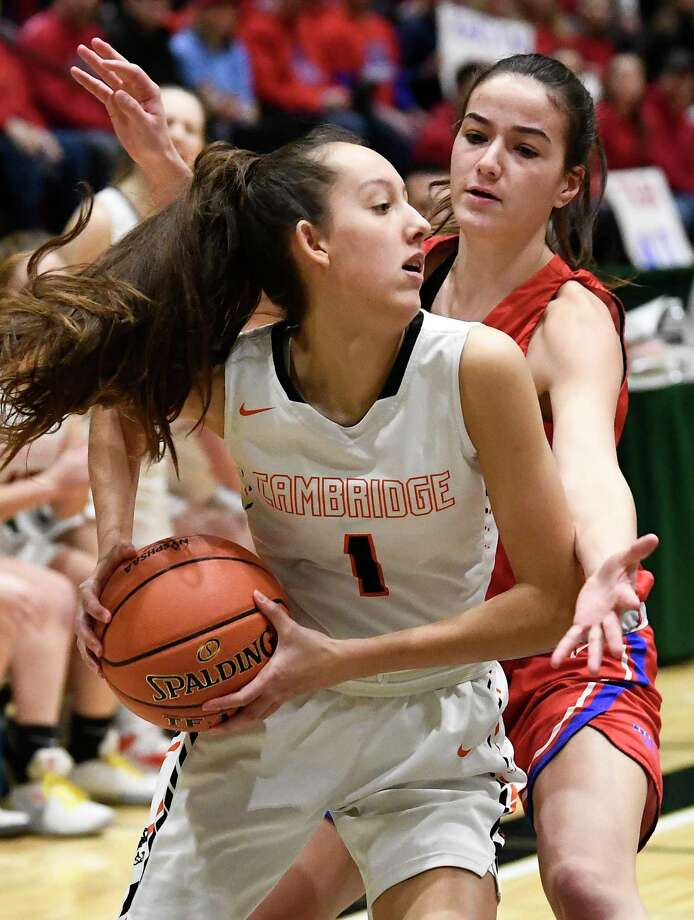 Cambridge's Lilly Phillips (1) is defended by Maple Hill's Natasha Strock (40) during a girls' Section II Class C high school championship basketball game Saturday, March 7, 2020 in Troy, N.Y. (Hans Pennink / Special to the Times Union)