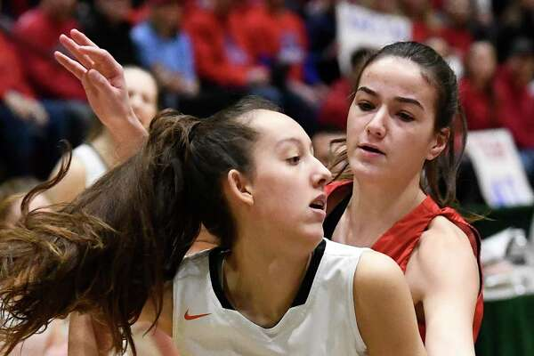 Cambridge's Lilly Phillips (1) is defended by Maple Hill's Natasha Strock (40) during a girls' Section II Class C high school championship basketball game Saturday, March 7, 2020 in Troy, N.Y. (Hans Pennink / Special to the Times Union) ORG XMIT: 030820_hsbb_girls3_HP112
