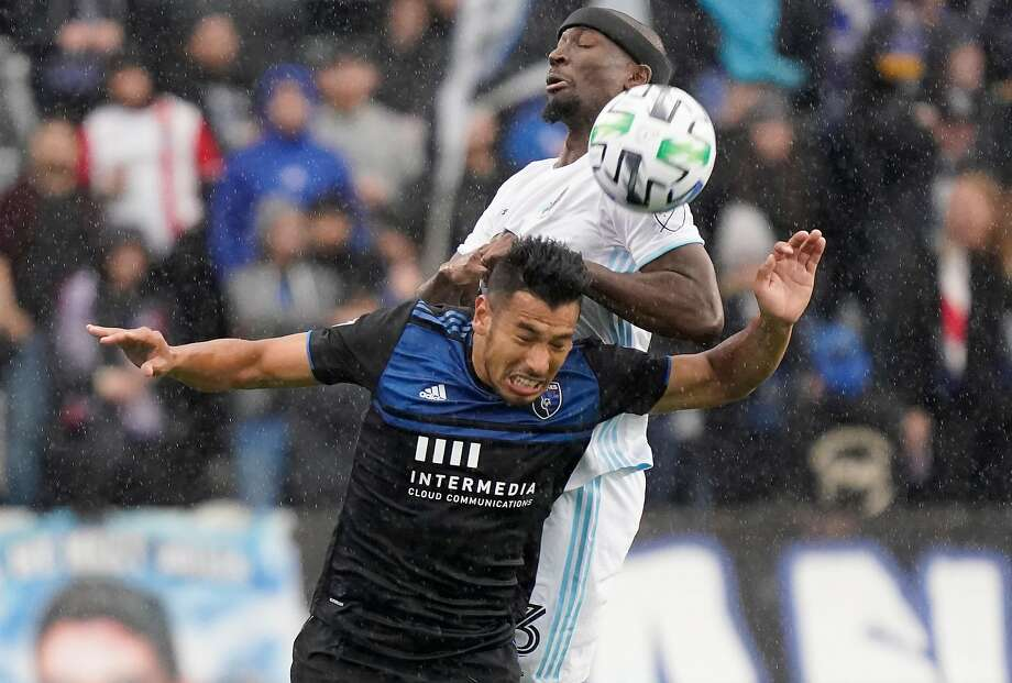 Ike Opara rises above San Jose forward Andres Rios during Minnesota United FC's 5-2 rout at Earthquakes Stadium. Photo: Thearon W. Henderson / Getty Images