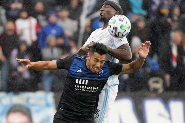 SAN JOSE, CALIFORNIA - MARCH 07: Andres Rios #25 of San Jose Earthquakes hits a header over the top of Ike Opara #3 of the Minnesota United FC during the first half of their MLS Soccer game in the first half at Earthquakes Stadium on March 07, 2020 in San Jose, California. (Photo by Thearon W. Henderson/Getty Images)