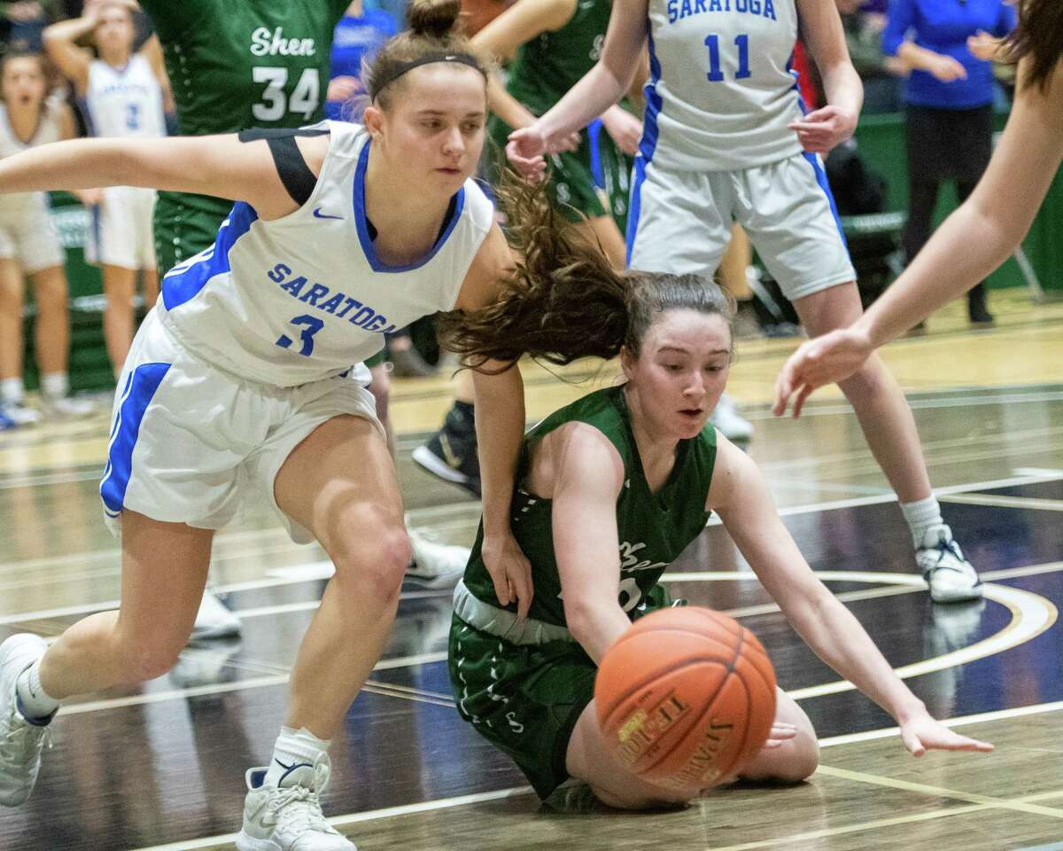 Saratoga senior Dolly Cairns and Shenendehowa junior Meghan Huerter scramble for a loose ball in the Section II, Class AA finals at Hudson Valley Community College in Troy NY on Saturday, March 7, 2020 (Jim Franco/Special to the Times Union.)