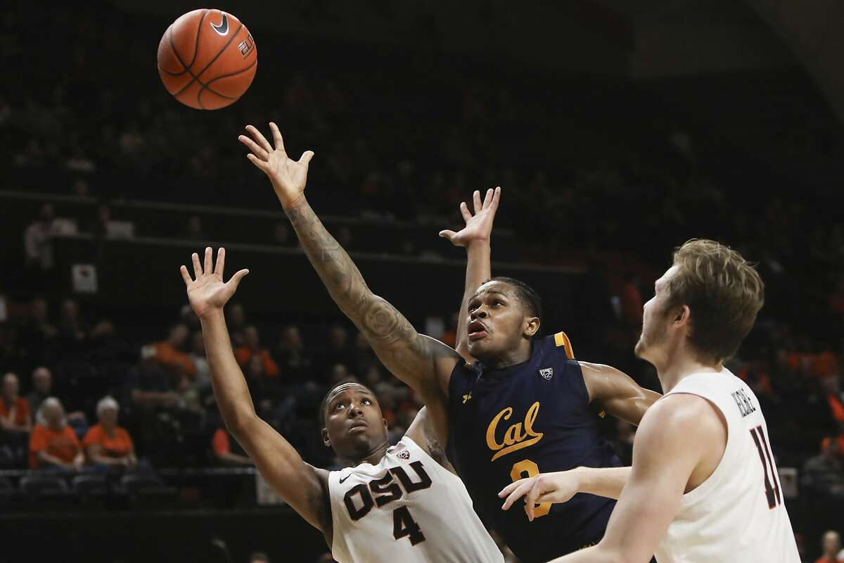 California's Paris Austin (3) shoots over Oregon State's Alfred Hollins (4) and Zach Reichle (11) during the second half of an NCAA college basketball game in Corvallis, Ore., Saturday, March 7, 2020. (AP Photo/Amanda Loman)