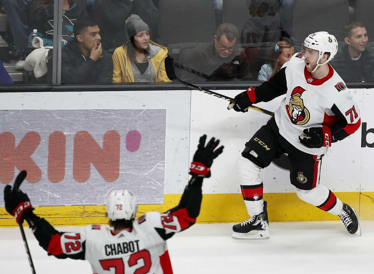 Ottawa Senators center Chris Tierney (71) celebrates his overtime goal to beat the Sharks 2-1 at SAP Center as defenseman Thomas Chabot rushes to join him. Ottawa won for the fourth time in its past five games.
